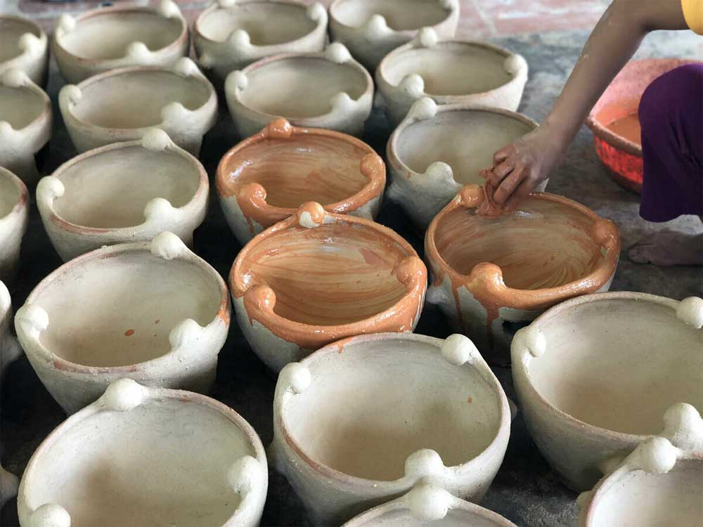 82-year-old woman, unique Cham pottery techniques, keep alive, Don Thi Hieu,  Binh Thuan Province, wooden pottery wheel, popular destination