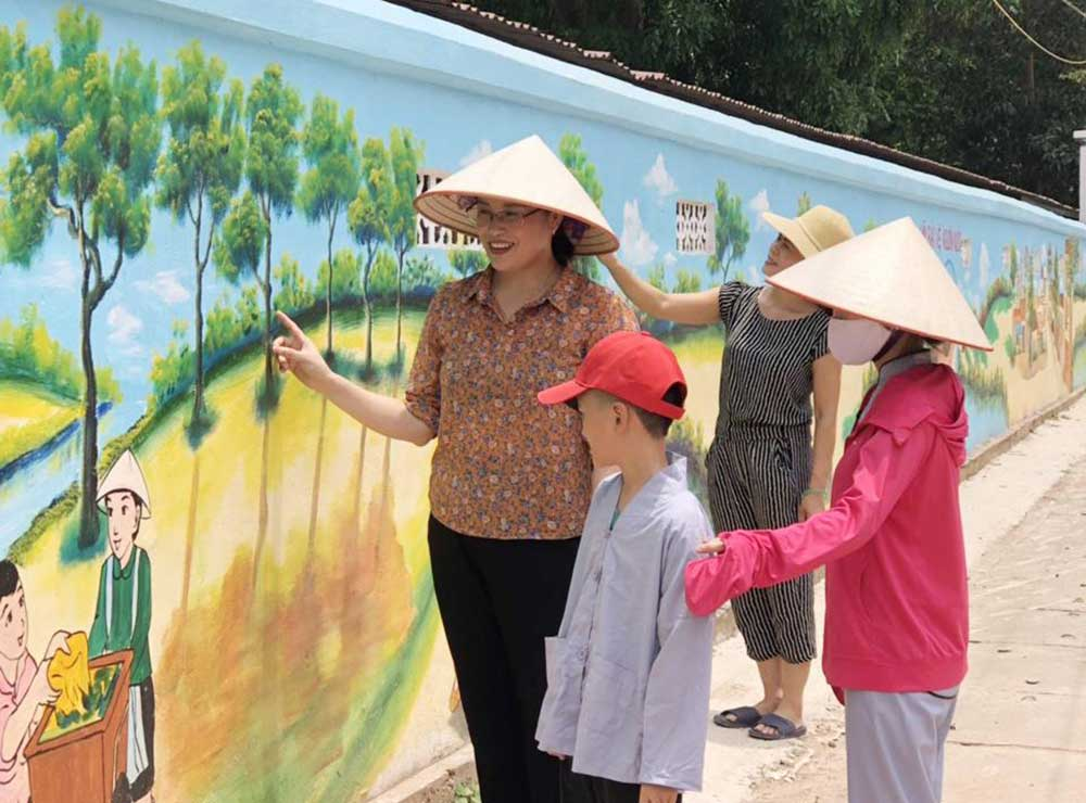 Bac Giang province, kind hearted people, Mai Hoa, Women's Union, hometown construction, long mural street, strong belief