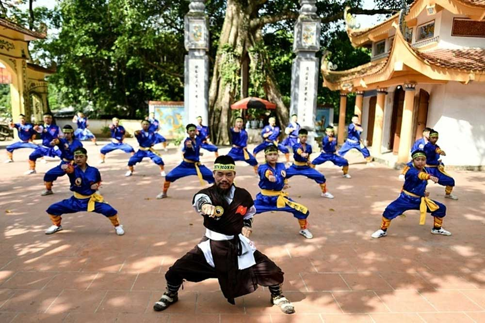 Ancient eye-popping martial art, gains popularity, modern Vietnam, sunny temple courtyard,  iron rod,  eye socket, mental well being, Thien Mon Dao