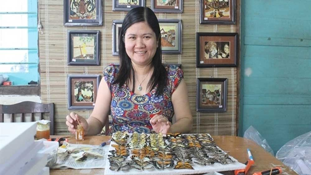 Artisan makes art from butterfly wings
