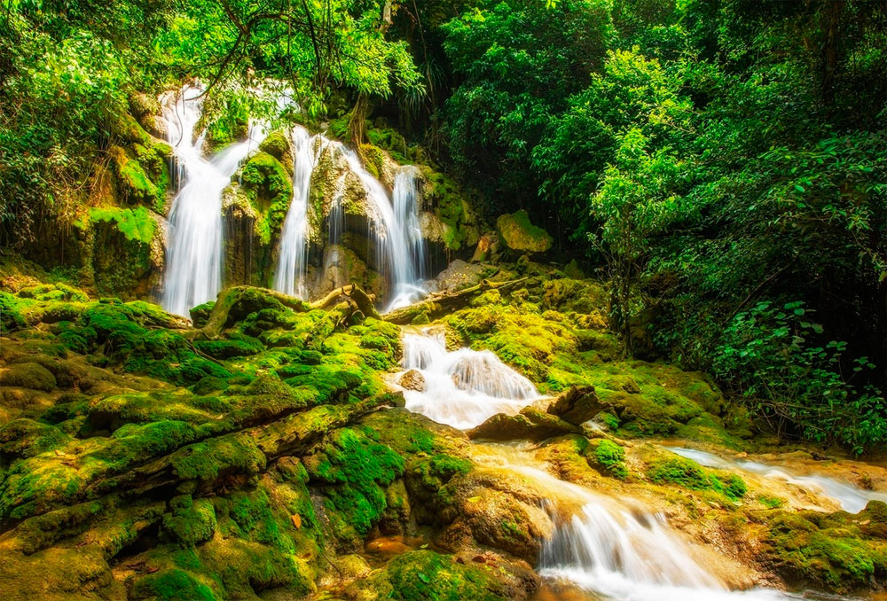Huu Lien, grass is greener,  Lang Son Province, sight for sore eyes, spectacular limestone hills, undulating vast grasslands, moss-covered waterfalls, emerald lakes