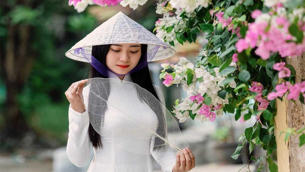 Tradition, a twist,  turns almond leaves, transparent conical hat