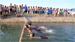 PE teacher keeps flood-hit youth afloat with free swimming lessons