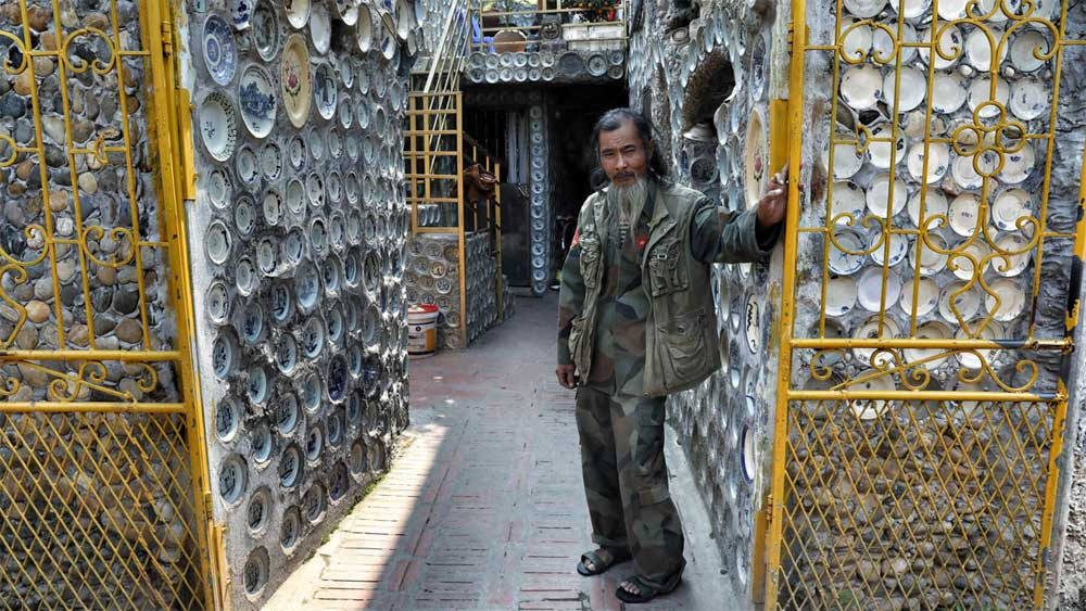 Vietnamese man embeds 13,000 ceramic plates in house walls