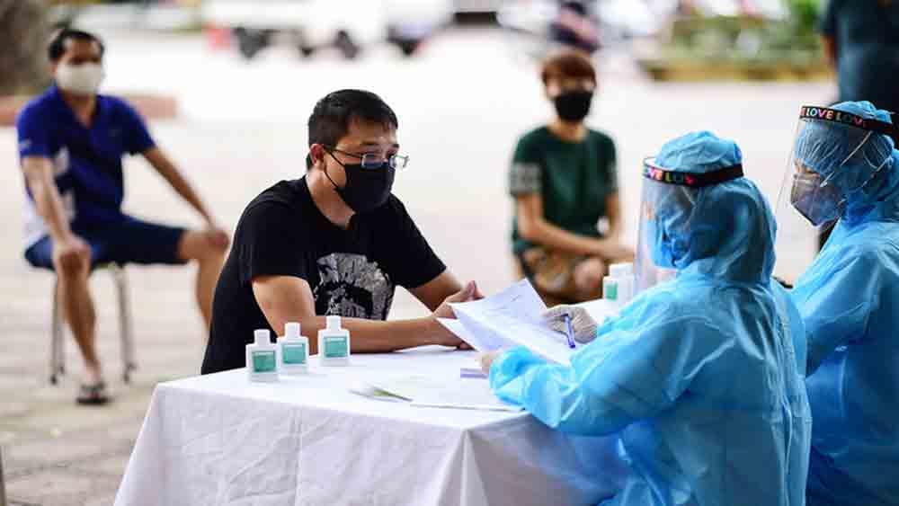 Hanoi, 800 returnees, Da Nang city, tourist hotspot,  Covid-19 outbreak, protective clothing, community transmission