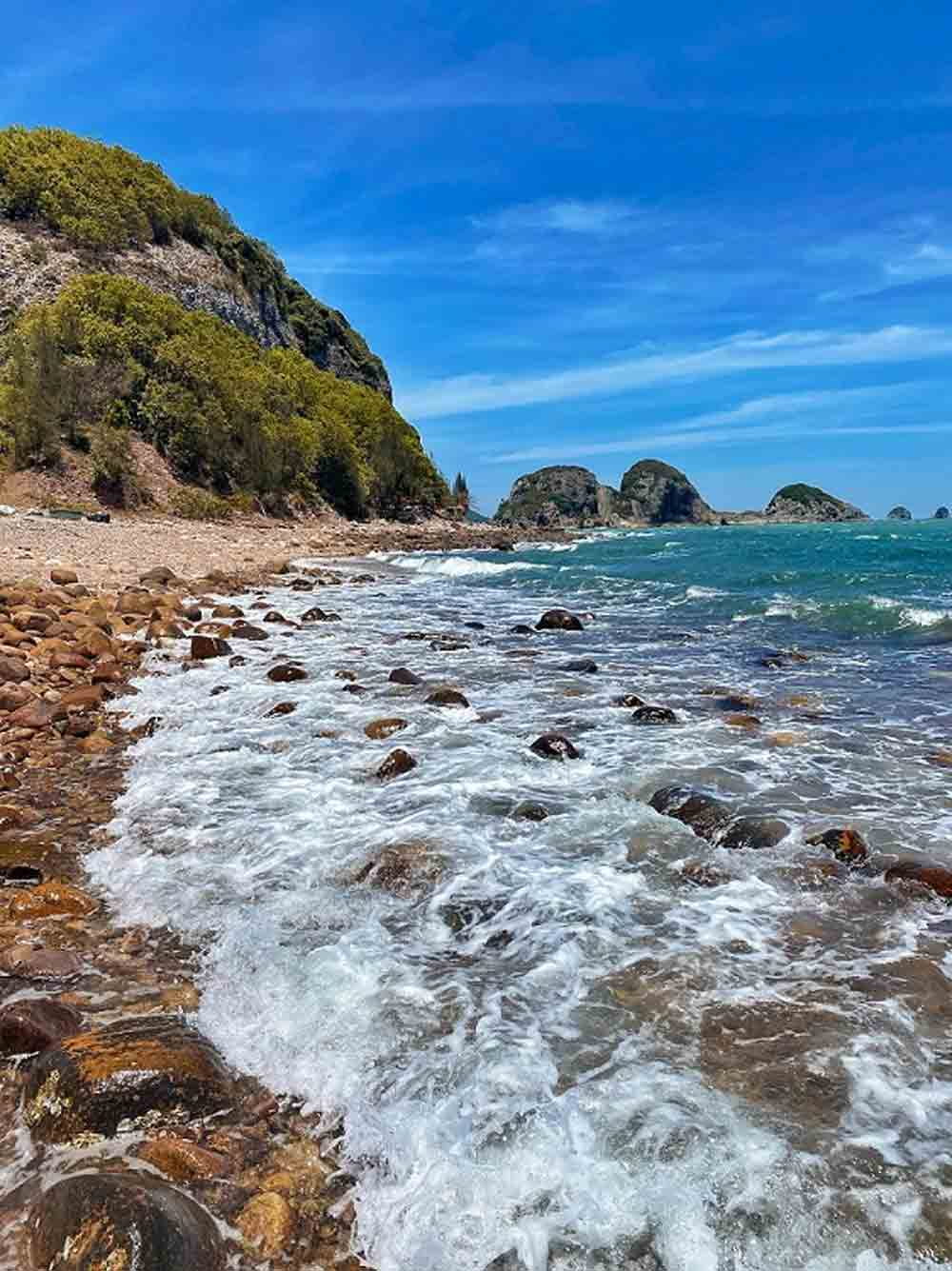 Bai Dong, unexplored beach, central Vietnam, lesser known beach,  beauty and tranquility, round trip ticket, coral diving and swimming