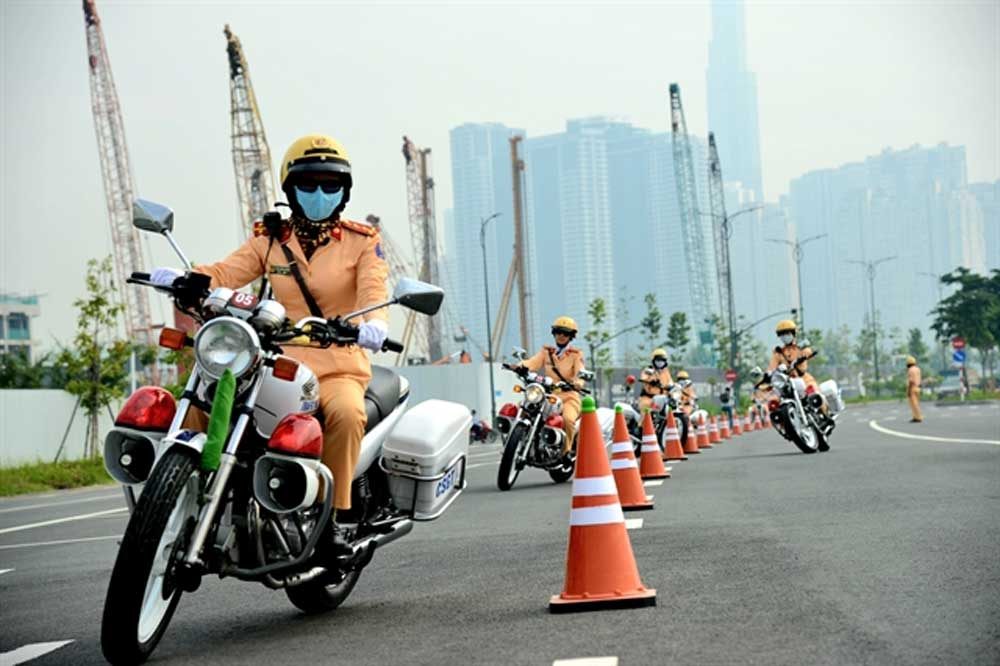 HCM City, all-female police, escort team, important dignitaries, domestic or foreign, bustling traffic, strong political will, high pressure