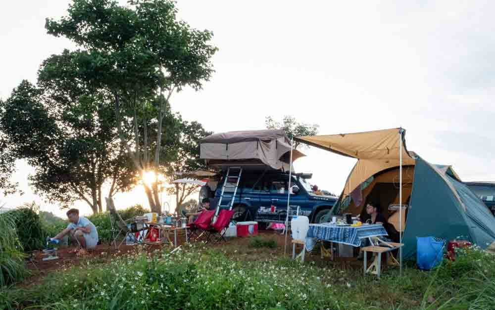 Camping, Central Highlands lake Ta Dung, mesmerizing camping, charming emerald hue, forest-green islands, Ta Dung National Park