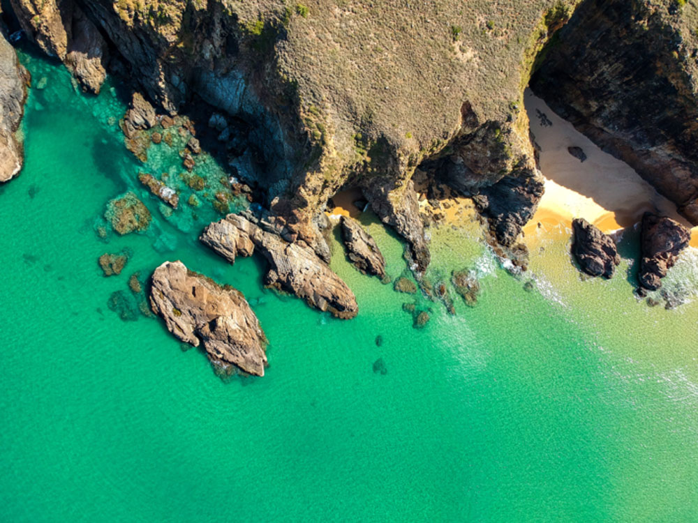 Ky Co Beach, emerald, Quy Nhon's crown, crescent-shaped coastline,  crystal-clear water, distinctive beauty, private island