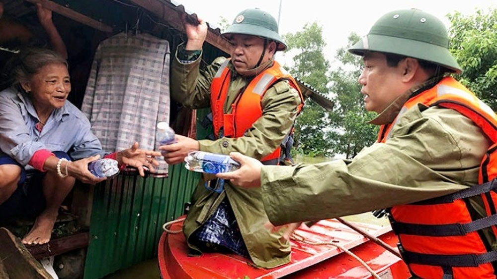 Central Vietnam, reeling from flooding, further heavy rains, weakened tropical storm, massive amount of rain, serious flooding, national disaster