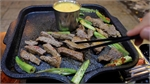 HCMC eatery's signature dish: stone-grilled beef in salted egg sauce