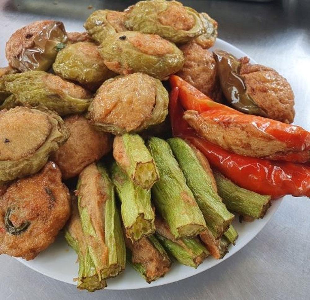 A Saigon banh mi, get stuffed, crunchy baguette,   fish cake, satiating gourmet palettes, typical cultural features