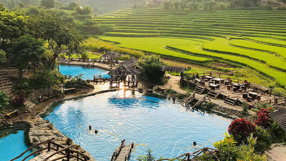 Vietnamese hot springs, revive the senses, beauty of nature, various temperatures, stilt house, hot-spring baths, forest canopy