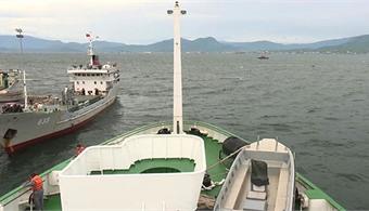 Hong Kong cargo ship saves three Vietnamese fishermen after boat sinks in storm