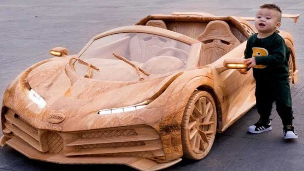 Ride in style: 'car-penter' dad builds wooden Bugatti for son
