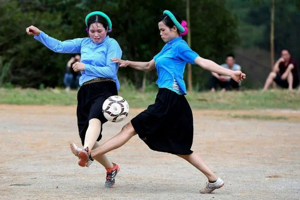 Farmers and football, Vietnamese women, scoring big, rice terraces, female farmers,  colorful cloth, headbands, game of football