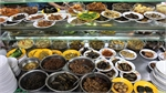 50 side-dishes allure night owls to Saigon porridge stall