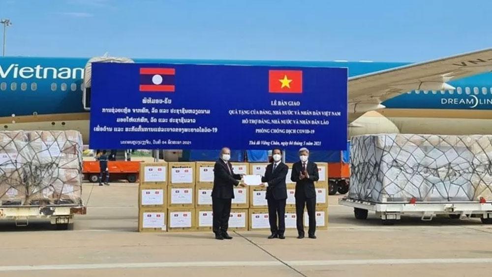 Vietnam, presents Laos, medical equipment, Covid-19 fight, Covid-19 pandemic, field hospitals, financial support