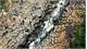 Impressive stone blocks across Jrai Pha stream in Gia Lai