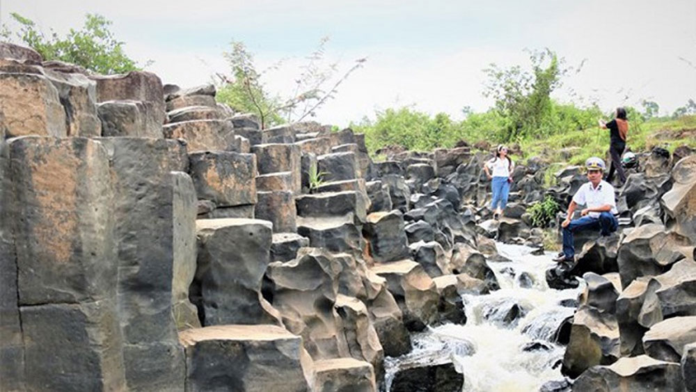 Impressive stone blocks, Jrai Pha stream, Gia Lai province, nature lovers, unique stream, ancient rocky outcrop